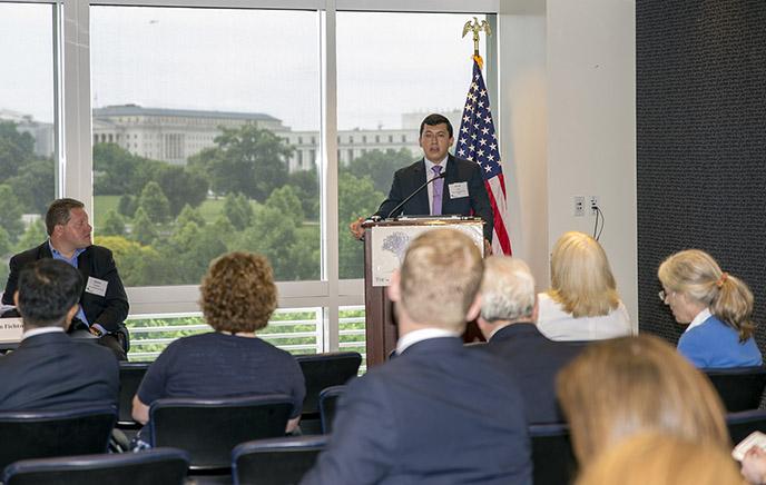 Evan Avila addresses the 2018 iOme Challenge Symposium